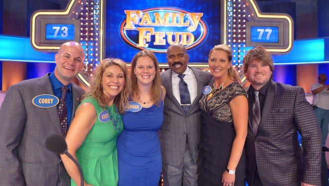 "The ""Knigge Kousins"" team join host Steve Harvey on the set of Family Feud, from left, Corey Geiger, Krista Knigge, Hannah Steen, Harvey, Kelly Steelman, and Chris Steelman"