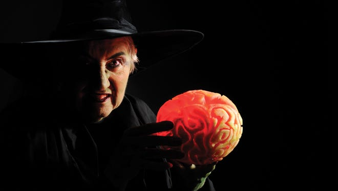 With a little carving, you can create a creepy Halloween brain from a personal-sized watermelon.