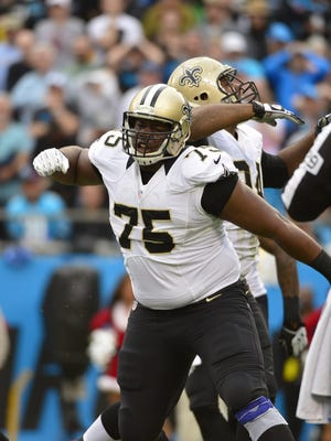 New Orleans Saints defensive end Tyrunn Walker reacts against the Carolina Panthers on Dec. 22, 2013.