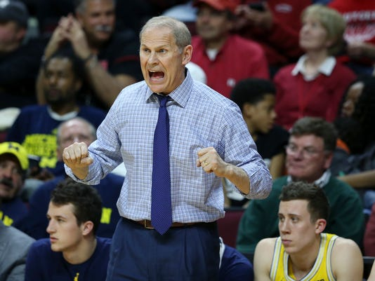 Michigan coach John Beilein shouts to his players during the first half of an NCAA college basketball game against Rutgers on Wednesday, Feb. 22, 2017, in Piscataway, N.J. Michigan won 68-64. (AP Photo/Mel Evans)