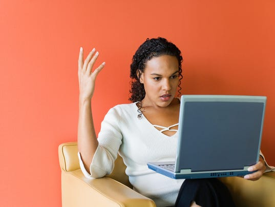 Frustrated businesswoman with laptop computer