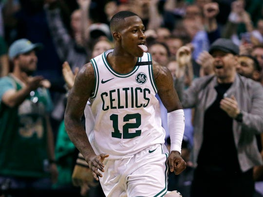 Boston Celtics guard Terry Rozier celebrates after a driving to the basket late in the fourth quarter against the Philadelphia 76ers in Game 5 of an NBA basketball playoff series in Boston, Wednesday, May 9, 2018. Rozier scored 24 points as the Celtics defeated the 76ers 114-112. (AP Photo/Charles Krupa)