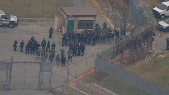 Police staged inside the prison during the hostage crisis at Vaughn Correctional Center.