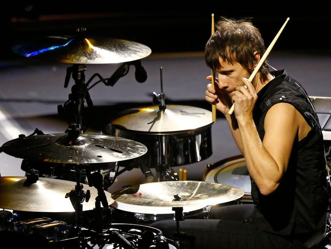 Dominic Howard of Muse performs their Drones Tour to