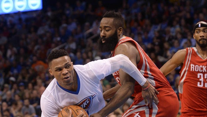 Mar 22, 2016; Oklahoma City, OK, USA; Oklahoma City Thunder guard Russell Westbrook (0) drives to the basket in front of Houston Rockets guard James Harden (13) during the fourth quarter at Chesapeake Energy Arena. Mandatory Credit: Mark D. Smith-USA TODAY Sports