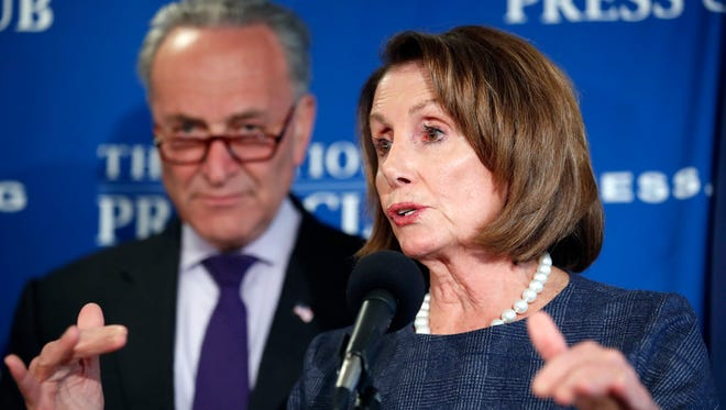 House Minority Leader Nancy Pelosi of Calif., accompanied by Senate Minority Leader Chuck Schumer of N.Y., answers a reporter's question during a news conference at the National Press Club in Washington, Monday, Feb. 27, 2017. (AP Photo/Alex Brandon)
