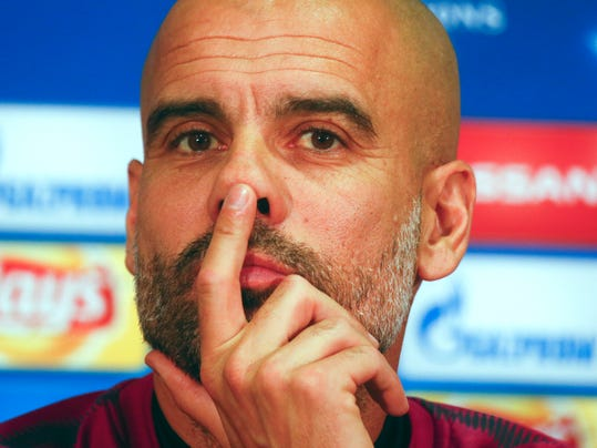 Manchester City manager Pep Guardiola attends a news conference in Kharkiv, Ukraine, Tuesday, Dec. 5, 2017. Manchester City will face Shakhtar Donetsk in Group F Champions League soccer match at the Metalist Stadium on Wednesday. (AP Photo/Efrem Lukatsky)