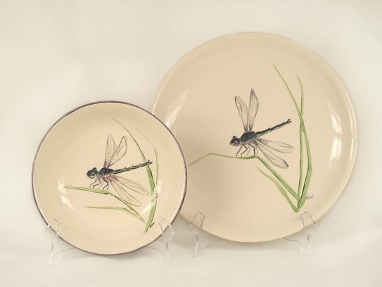 Dragonflies dance across pottery by Marguerite Cotter.