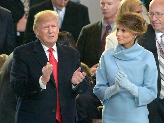 President Trump and first lady Melania Trump applaud