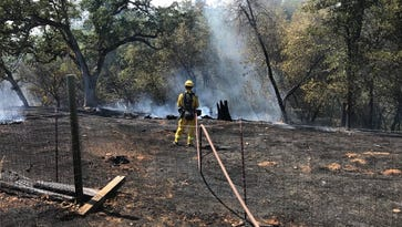 Crews contain vegetation fire in Happy Valley