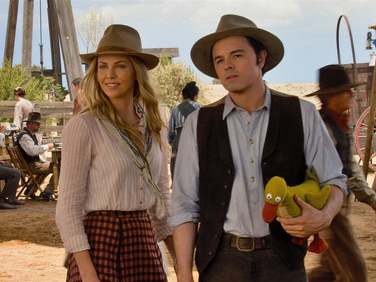 """Charlize Theron and Seth MacFarlane in a scene from """"A Million Ways to Die in the West."""""""