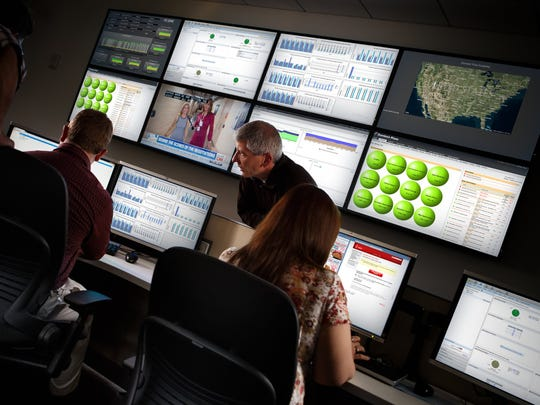 Domino's employees are in the NOC or Network Operations Center, monitoring store computer systems. Domino's corporate and franchise stores across the country are networked and the NOC team monitors the systems and troubleshoot any problems.
