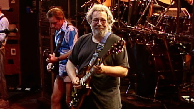 Bob Weir (left) and Jerry Garcia of the Grateful Dead on July 19, 1989, at Alpine Valley in East Troy, Wisconsin.