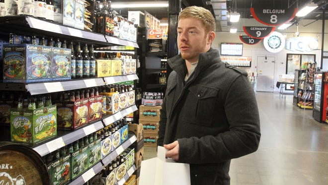 Peter Sieminski talks about the possibility of a brew-pub in Half Time Beverage, while shopping in the Mamaroneck beer distributor Jan. 6, 2017.