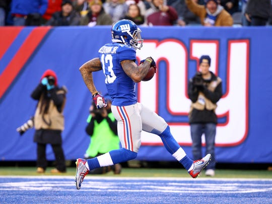 Odell Beckham Jr. #13 of the New York Giants scores a 35 yard touchdown in the third quarter against the Washington Redskins during their game at MetLife Stadium on December 14, 2014 in East Rutherford, New Jersey.
