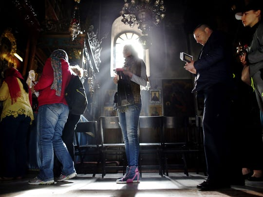 Foreign Christian worshipers wait in line to pray in