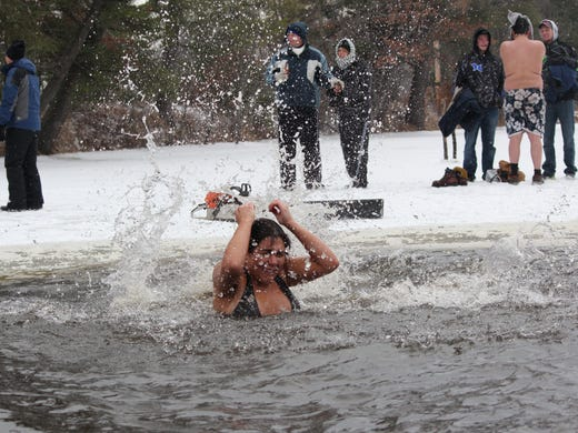 New year starts with icy plunge at Polar Bear Swim