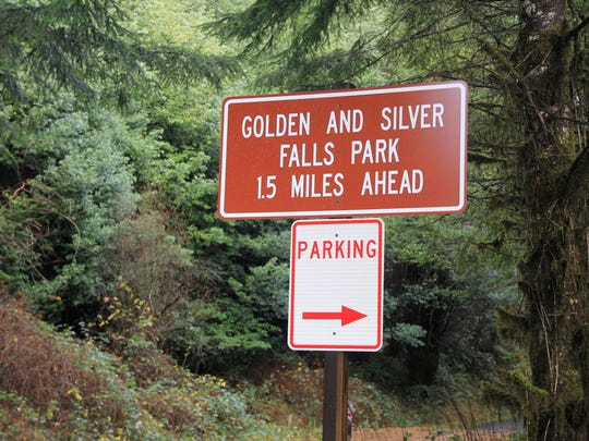 Signs inform those visiting Golden and Silver Falls State Natural Area that due to a road washout on Glenn Creek Road, they must hike an extra mile and a half to reach the actual park.