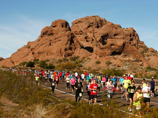 Runners pass through the buttes on East McDowell Road