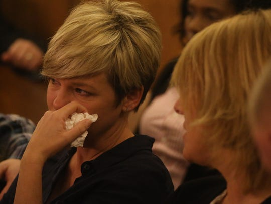 Julie Thomas, a family member of Carla Pearman, reacts