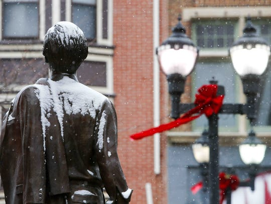 Snow collects on the statue of former Wilmington Mayor Thomas C. Maloney along North Market. The statue has been removed for cleaning and repairs.
