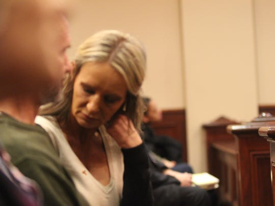 A family member of Darrell Willis, looks away as autopsy