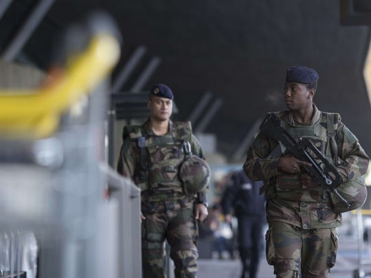 French soldiers patrol a terminal at Charles de Gaulle