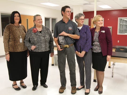 """James Marc Jones, a veterinary assisting instructor at South Fort Myers High School, was presented the """"2015 Teacher of The Year"""" award by the Lee County School District."""