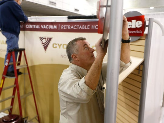Doug Fisher sets up his stand for Cyclovac and Miele, a home vacuum system and appliance vender, during a previous North Florida Home Show at the Civic Center. This year's show is Feb. 8-10.