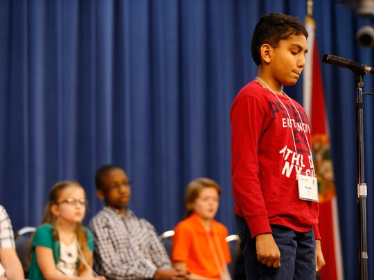 Farzan Shiju spells out a given word during the Tallahassee Democrat Big Bend Regional Spelling in February.