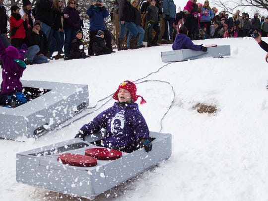 Cardboard sled races and chili cook-off during Festivus at Leila Arboretum last Saturday.