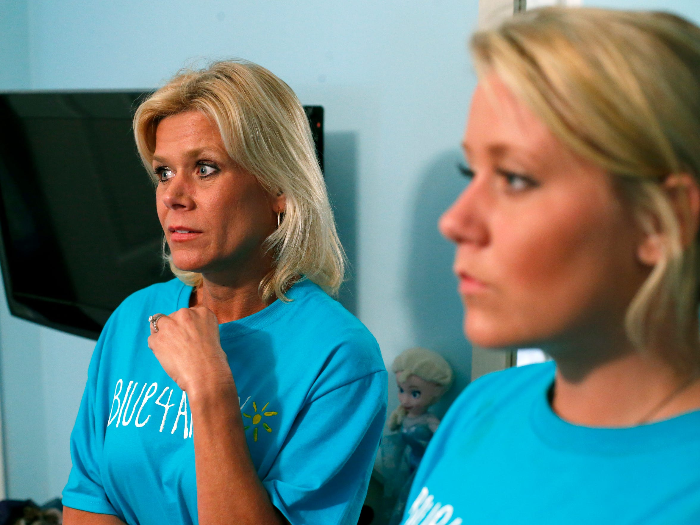 Christi Rayborn stands with her daughter Ashlyn, 16,