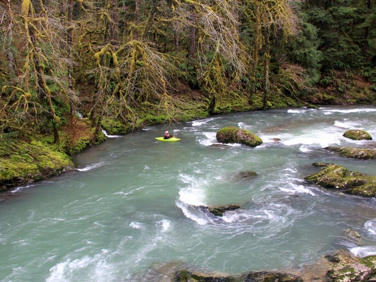Kayking the upper stretches of the South Santiam River means dodging plenty of boulders. Seen here is Laurie Pavey.