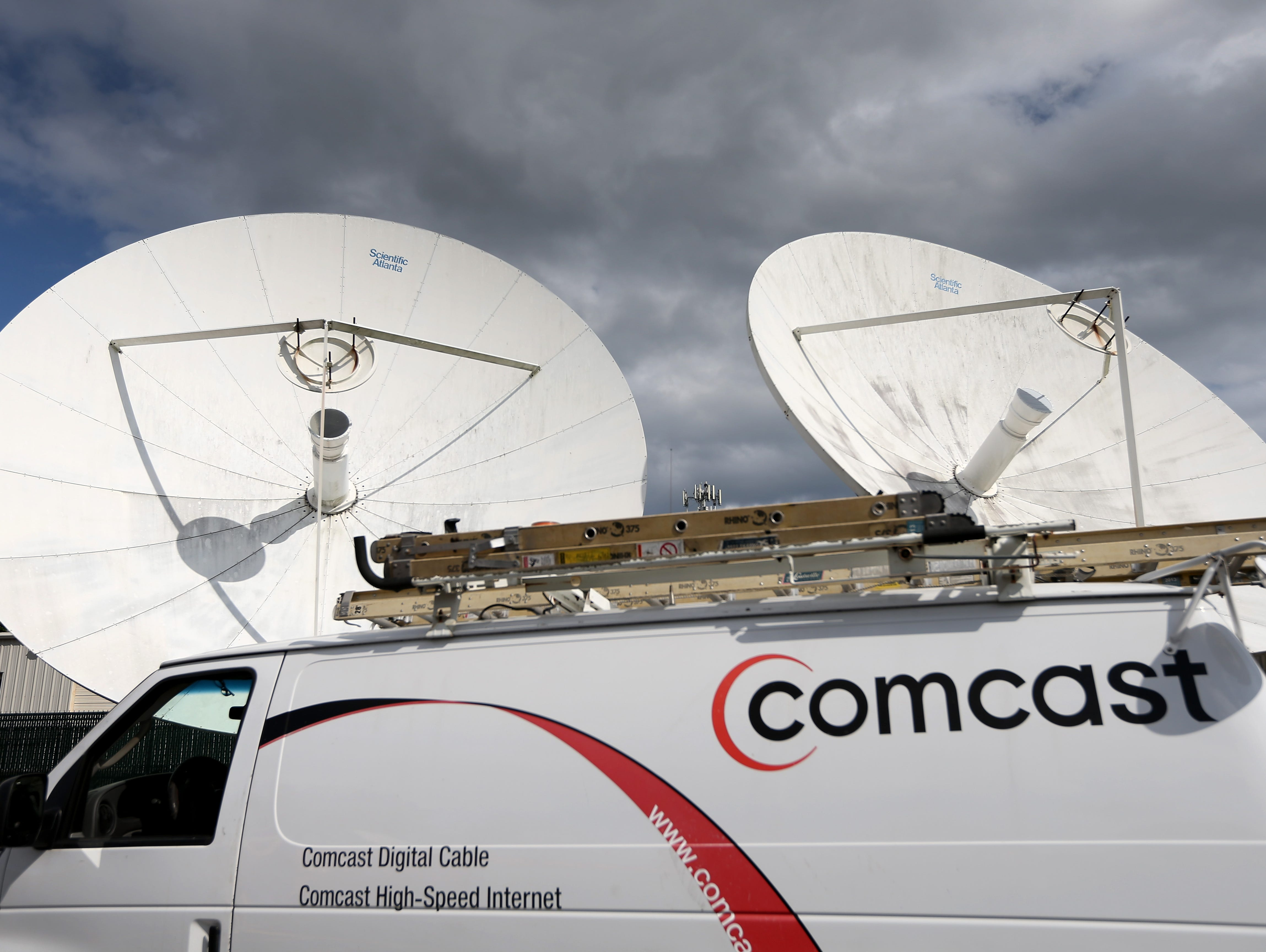 FILE - JULY 22:  Comcast Corp. reports its year-end  and fourth quarter earnings on Feb. 24, 2014.  POMPANO BEACH, FL - FEBRUARY 13:  A Comcast truck is seen parked at one of their centers on February 13, 2014 in Pompano Beach, Florida.  Today, Comca