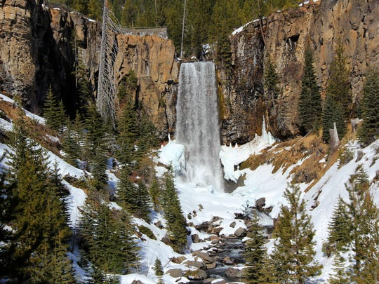 Tumalo Falls roars into the snowy canyon below. The falls can be reached in winter via the Road 4603 Trail.