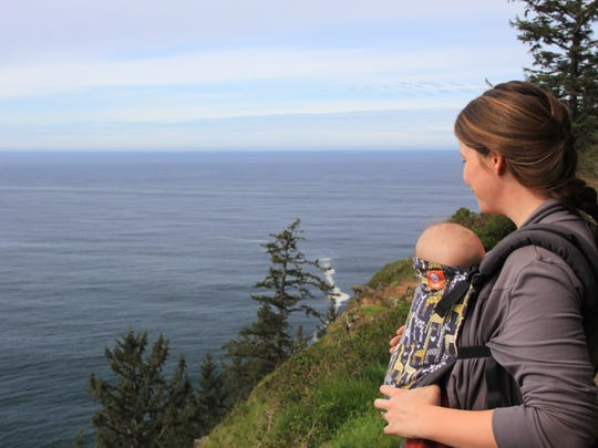 Robyn Orr hikes with her 5-month-old daughter Lucy on the Cape Trail at Cape Lookout State Park on the Oregon Coast south of Tillamook.