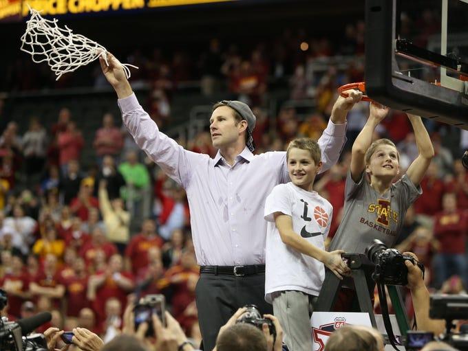 Iowa State head coach Fred Hoiberg cuts down the net