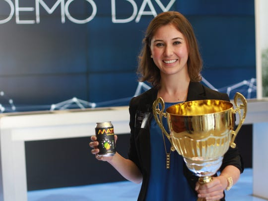 Tatiana Birgisson, 25, clutches her trophy -- and a