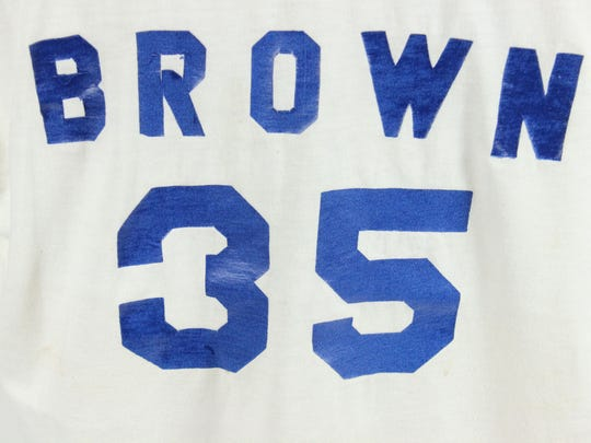 This white jockey size XL t-shirt features Roger Brown's name and number on the back. That same number, 35, would go on to be retired by the Pacers.