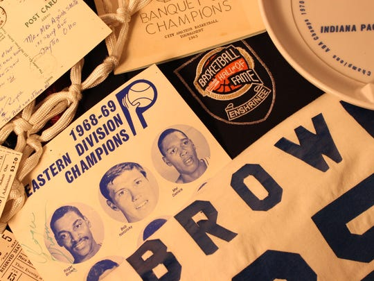 A collage of former Indiana Pacers player Roger Brown's items that are up for auction.