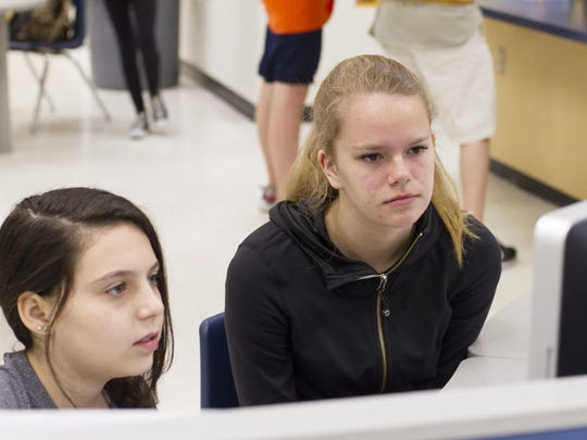 7th graders Victoria White and Bryn Parker work together