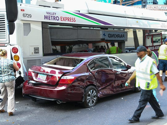 A car and two buses were in an accident on Van Buren Street near 2nd Street in Phoenix on Monday, June 8, 2015.