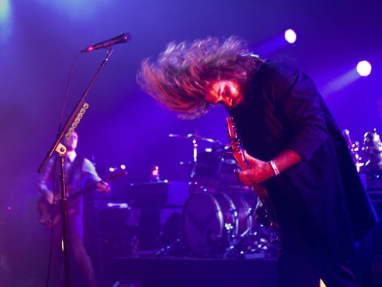 Jim James of My Morning Jacket plays guitar as the band performs at Philadelphia's Mann Center on their Curcuital Tour.