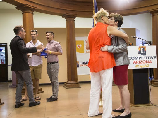 Sue Wieger (left) rejoices with her partner Shelia Kloefkorn amid announcement of the Supreme Court decision Friday on same-sex marriages. The high court's ruling expands marriage nationwide.