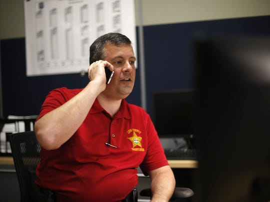 Leon County Lieutenant Tony Drzewiecki answers a call from Sheriff Mike Wood from his office at the CDA on Tuesday, June 9, 2015.
