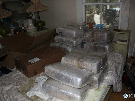 HSI discovers bundles of marijuana in abandoned house