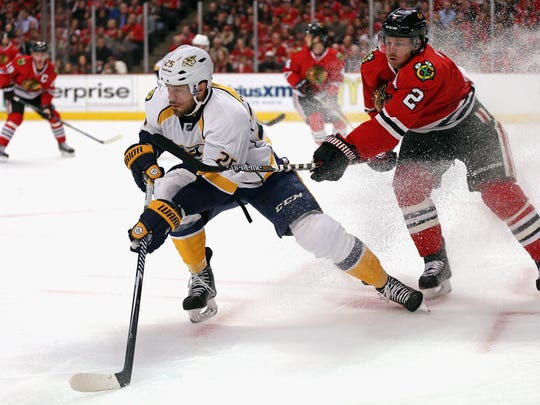 Nashville's Viktor Stalberg, left, moves with the puck during the 2015 Stanley Cup playoffs..