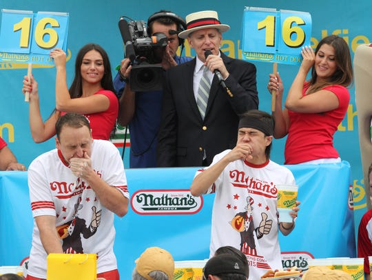 Joey Chestnut, left, and Matt Stonie compete in Nathan's