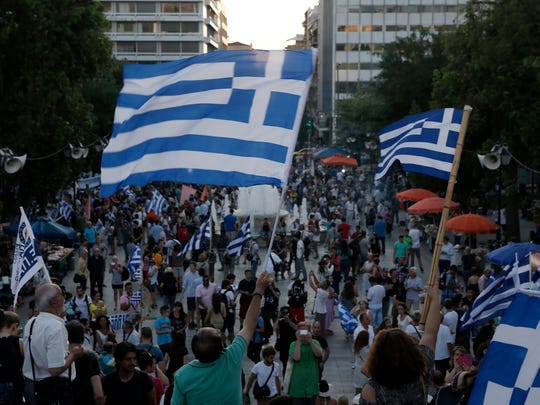 Supporters of the no vote wave Greek flags in Syntagma