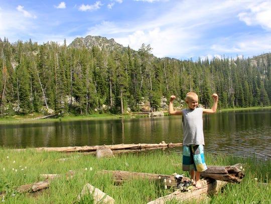 Noah Peters, 7, celebrates hiking to Black Lake in